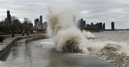 Strong waves crash against the Lake Michigan waterfront at the 31st Street Beach on the south side of Chicago on Tuesday, Oct. 30, 2012. Strong winds from the outer edge of superstorm Sandy are creating near-record high waves on Lake Michigan.   <span class=meta>(AP Photo&#47; Charles Rex Arbogast)</span>