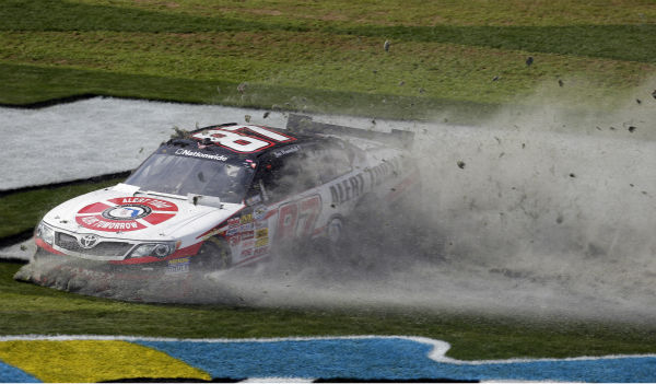 Driver Joe Nemechek slides through the grass after losing control of his car during the NASCAR Nationwide Series auto race Saturday, Feb. 23, 2013, at Daytona International Speedway in Daytona Beach, Fla. &#40;AP Photo&#47;Chris O&#39;Meara&#41;  <span class=meta>(AP Photo&#47; Chris O&#39;Meara)</span>