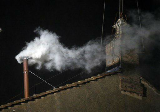 White smoke emerges from the chimney on the roof of the Sistine Chapel, in St. Peter&#39;s Square at the Vatican, Wednesday, March 13, 2013. The white smoke indicates that the new pope has been elected.   <span class=meta>(AP Photo&#47; Gregorio Borgia)</span>