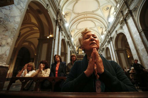 "<div class=""meta image-caption""><div class=""origin-logo origin-image ""><span></span></div><span class=""caption-text"">A woman prays inside the Metropolitan Cathedral in Buenos Aires, Argentina,  Wednesday, March 13, 2013.  White smoke billowed from the chimney of the Sistine Chapel, Wednesday evening, in Vatican City, meaning 115 cardinals in a papal conclave elected a new leader for the world's 1.2 billion Catholics.   (AP Photo/ Victor R. Caivano)</span></div>"