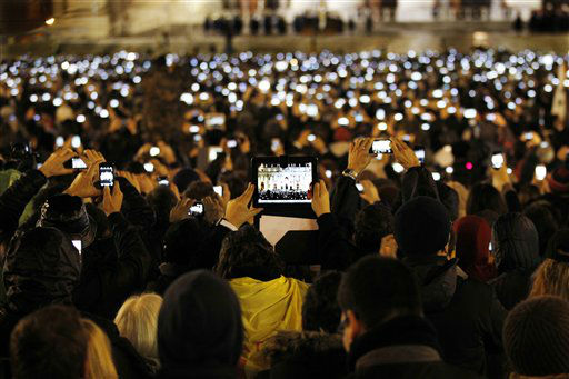 "<div class=""meta ""><span class=""caption-text "">Visitors take photos of Pope Francis as he speaks from the central balcony of St. Peter's Basilica at the Vatican, Wednesday, March 13, 2013. Cardinal Jorge Bergoglio, who chose the name of Francis is the 266th pontiff of the Roman Catholic Church.   (AP Photo/ Michael Sohn)</span></div>"