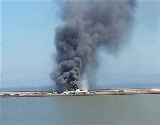 This photo provided by Antonette Edwards shows what a federal aviation official says was an Asiana Airlines flight crashing while landing at San Francisco airport on Saturday, July 6, 2013.   <span class=meta>(AP Photo&#47; Antonette Edwards)</span>