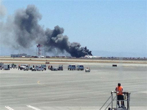 "<div class=""meta ""><span class=""caption-text "">This photo provided by Krista Seiden shows smoke rising from what a federal aviation official says was an Asiana Airlines flight crashing while landing at San Francisco airport on Saturday, July 6, 2013.   (AP Photo/ Krista Seiden)</span></div>"