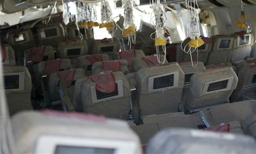 "<div class=""meta ""><span class=""caption-text "">This image released by the National Transportation Safety Board, Sunday, July 7, 2013, shows the interior of the Boeing 777 Asiana Airlines Flight 214 aircraft. The Asiana flight crashed upon landing Saturday, July 6, at San Francisco International Airport, and two of the 307 passengers aboard were killed.   (AP Photo/ Uncredited)</span></div>"
