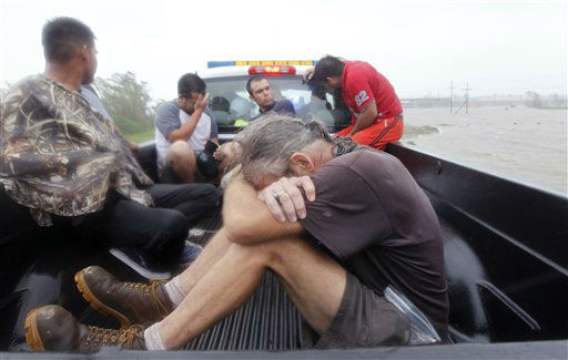 Residents who were rescued from their flooded homes are transported to waiting assistance, after Hurricane Isaac made landfall and flooded homes with 10 feet of water in Braithwaite, La., Wednesday, Aug. 29, 2012.  Isaac was packing 80 mph winds, making it a Category 1 hurricane. It came ashore early Tuesday near the mouth of the Mississippi River, driving a wall of water nearly 11 feet high inland and soaking a neck of land that stretches into the Gulf.    <span class=meta>(AP Photo&#47; Gerald Herbert)</span>