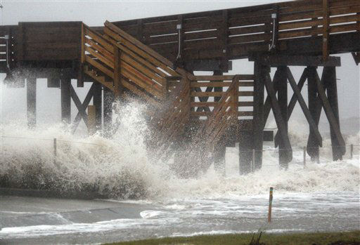 "<div class=""meta image-caption""><div class=""origin-logo origin-image ""><span></span></div><span class=""caption-text"">The St. Stanislaus pier alongside the Beach Boulevard seawall in Bay St. Louis, Miss., is hit by Isaac's winds and storm surges that are flooding some low laying neighborhoods, Wednesday, Aug. 29, 2012, the seventh  anniversary of Hurricane Katrina hitting the Gulf Coast. Isaac was packing 80 mph winds, making it a Category 1 hurricane. It came ashore early Tuesday near the mouth of the Mississippi River, driving a wall of water nearly 11 feet high inland and soaking a neck of land that stretches into the Gulf.    (AP Photo/ Rogelio V. Solis)</span></div>"
