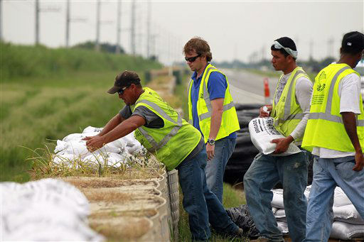 Workers stack sandbags on top of retaining wall baskets in preparation for Tropical Storm Isaac, which is expected to make landfall on the Louisiana coast as a hurricane, in Port Sulphur, La., Monday, Aug. 27, 2012.   <span class=meta>(AP Photo&#47; Gerald Herbert)</span>