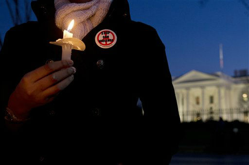 Lindsay Merikas, 26, of Alexandria, Va., wears a button saying &#34;Stop Gun Violence&#34; as she gathered with other supporters of gun control on Pennsylvania Avenue in front of the White House, in Washington, Friday, Dec. 14, 2012, during a vigil for the victims of the shooting at Sandy Hook Elementary School in Newtown, Ct., and to call on President Obama to pass strong gun control laws.   <span class=meta>(AP Photo&#47; Jacquelyn Martin)</span>