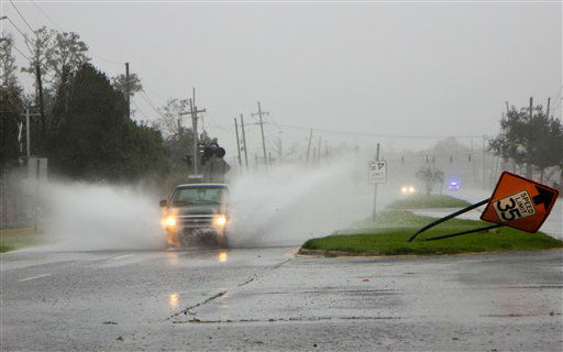 A pickup truck drives through standing water near Belle Chasse, La., in Plaquemines Parish, a rural area outside New Orleans that was flooded during Hurricane Isaac on Wednesday, Aug. 29, 2012.   <span class=meta>(AP Photo&#47; Erik Schelzig)</span>
