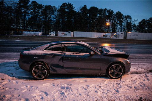 A car sits abandoned on I-285 Wednesday, January 29, 2014 in Dunwoody, Ga.   <span class=meta>(AP Photo&#47;Branden Camp)</span>