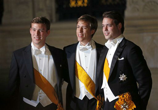 From left, Princes Sebastien, Prince Louis and Prince Felix of Luxembourg arrive for dinner at the Royal Palace on the occasion of the wedding of Luxembourg&#39;s heir Prince Guillaume and Countess Stephanie  in Luxembourg, Friday, Oct. 19, 2012. &#40;AP Photo&#47;Michael Probst&#41; <span class=meta>(AP Photo&#47; Michael Probst)</span>