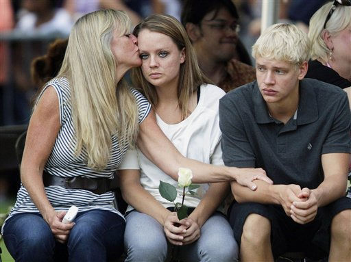 Family members of the victims of Friday&#39;s mass shooting in Aurora, Colo., comfort each other, Sunday, July 22, 2012, in Aurora, Colo., during a prayer vigil for the victims. Twelve people were killed and dozens were injured in a shooting attack Friday at the packed theater during a showing of the Batman movie, &#34;The Dark Knight Rises.&#34; Police have identified the suspected shooter as James Holmes, 24. &#40;AP Photo&#47;Ted S. Warren&#41; <span class=meta>(AP Photo&#47; Ted S. Warren)</span>