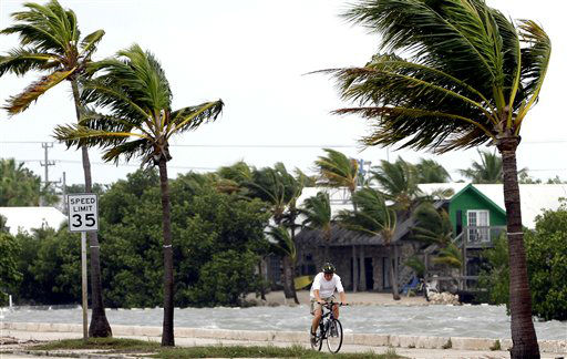 A cyclist rides his bike in Key West, Fla., Sunday, Aug. 26, 2012. Tropical Storm Isaac gained fresh muscle Sunday as it bore down on the Florida Keys, with forecasters warning it could grow into a dangerous Category 2 hurricane as it nears the northern Gulf Coast.   <span class=meta>(AP Photo&#47; Alan Diaz)</span>