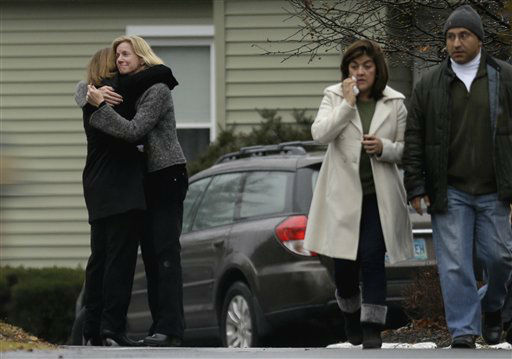 Mourners arrive for the funeral service of Sandy Hook Elementary School shooting victim, Jack Pinto, 6, Monday, Dec. 17, 2012, in Newtown, Conn. Pinto was killed when a gunman walked into Sandy Hook Elementary School in Newtown Friday and opened fire, killing 26 people, including 20 children.&#40;AP Photo&#47;David Goldman&#41; <span class=meta>(AP Photo&#47; David Goldman)</span>