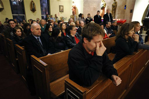 Mourners gather for a vigil service for victims of the Sandy Hook Elementary School shooting, at the St. Rose of Lima Roman Catholic Church in Newtown, Conn. Friday, Dec. 14, 2012. A man killed his mother at their home and then opened fire Friday inside the elementary school where she taught, massacring 26 people, including 20 children, as youngsters cowered in fear to the sound of gunshots reverberating through the building and screams echoing over the intercom (AP Photo/Andrew Gombert, Pool)