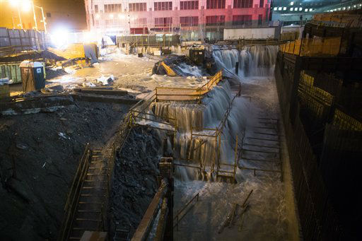 Sea water floods the Ground Zero construction site, Monday, Oct. 29, 2012, in New York. Sandy continued on its path Monday, as the storm forced the shutdown of mass transit, schools and financial markets, sending coastal residents fleeing, and threatening a dangerous mix of high winds and soaking rain.? &#40;AP Photo&#47; John Minchillo&#41; <span class=meta>(AP Photo&#47; John Minchillo)</span>