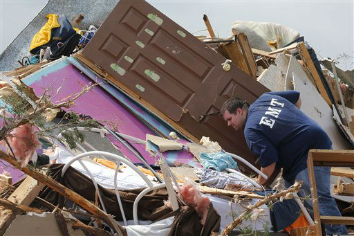 A resident who did not want to give his name, searches through the rubble of his mobile home in the Steelman Estates Mobile Home Park, destroyed by Sunday&#39;s tornado, near Shawnee, Okla., Monday, May 20, 2013. The tornado that slammed into Oklahoma on Sunday is now blamed for two deaths. Authorities say two men in their 70s have been found dead in or near a mobile home park outside of Shawnee.   <span class=meta>(AP Photo&#47; Sue Ogrocki)</span>