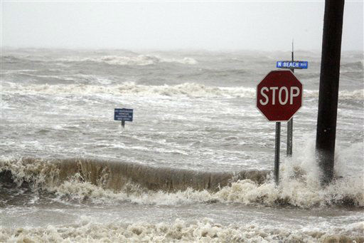 Isaac&#39;s winds and storm surge overcomes the seawall and floods Beach Boulevard in Waveland, Miss., Wednesday, Aug. 29, 2012, the seventh  anniversary of Hurricane Katrina hitting the Gulf Coast.   <span class=meta>(AP Photo&#47; Rogelio V. Solis)</span>