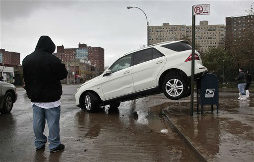 "<div class=""meta ""><span class=""caption-text "">The tailend of a SUV is perched on top of a postal mailbox in the aftermath of floods from Hurricane Sandy on Tuesday, Oct. 30, 2012, in Coney Island, N.Y. Sandy, the storm that made landfall Monday, caused multiple fatalities, halted mass transit and cut power to more than 6 million homes and businesses.   (AP Photo/ Bebeto Matthews)</span></div>"