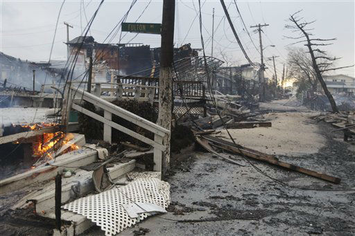 "<div class=""meta image-caption""><div class=""origin-logo origin-image ""><span></span></div><span class=""caption-text"">Damage caused by a fire at Breezy Point is shown Tuesday, Oct. 30, 2012, in in the New York City borough of Queen. The fire destroyed between 80 and 100 houses Monday night in the flooded neighborhood. More than 190 firefighters have contained the six-alarm blaze fire in the Breezy Point section, but they are still putting out some pockets of fire.   (AP Photo/ Frank Franklin II)</span></div>"