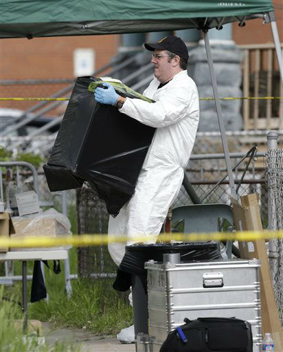 A member of the FBI evidence response team carries out evidence from a house Tuesday, May 7, 2013, where three women who vanished a decade ago were held, in Cleveland. Three women who disappeared in Cleveland a decade ago were found safe Monday, and police arrested three brothers accused of holding the victims against their will.   <span class=meta>(AP Photo&#47; Tony Dejak)</span>