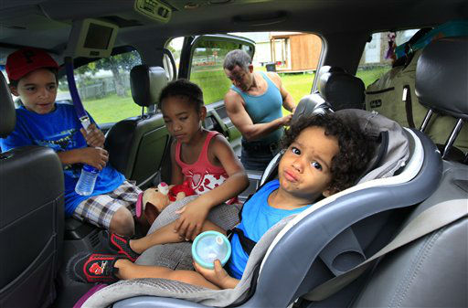 Estanislao Fabian loads the their car as Jordan Fabian, 6, and Jaylah Cole, 6, comfort Jaden Fabian, 1, as they evacuate their home in advance of Tropical Storm Isaac, which is expected to make landfall in the region as a hurricane this evening in Plaquemines Parish, La.,  Tuesday, Aug. 28, 2012. Forecasters at the National Hurricane Center warned that Isaac, especially if it strikes at high tide, could cause storm surges of up to 12 feet &#40;3.6 meters&#41; along the coasts of southeast Louisiana and Mississippi and up to 6 feet &#40;1.8 meters&#41; as far away as the Florida Panhandle.  <span class=meta>(AP Photo&#47; Gerald Herbert)</span>