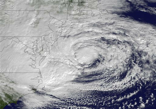 This NOAA satellite image taken Monday, Oct. 29, 2012 shows Hurricane Sandy off the Mid Atlantic coastline moving toward the north with maximum sustained winds of 90 mph. Hurricane Sandy wheeled toward land as forecasters feared Monday, raking cities along the Northeast corridor with rain and wind gusts, flooding shore towns, washing away a section of the Atlantic City Boardwalk, and threatening to cripple Wall Street and New York&#39;s subway system with a huge surge of corrosive seawater.  <span class=meta>(AP Photo&#47; Uncredited)</span>