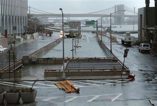 Water reaches the street level of the flooded Brooklyn Battery Tunnel, Tuesday, Oct. 30, 2012, in New York. Sandy arrived along the East Coast and morphed into a huge and problematic system, putting more than 7.5 million homes and businesses in the dark and causing a number of deaths.   <span class=meta>(AP Photo&#47; Louis Lanzano)</span>