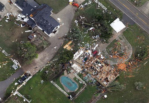"<div class=""meta ""><span class=""caption-text "">An aerial view shows homes damaged by Monday's tornado, Tuesday, May 21, 2013, in Moore, Okla. At least 24 people, including nine children, were killed in the massive tornado that flattened homes and a school in Moore, on Monday afternoon.   (AP Photo/ Tony Gutierrez)</span></div>"