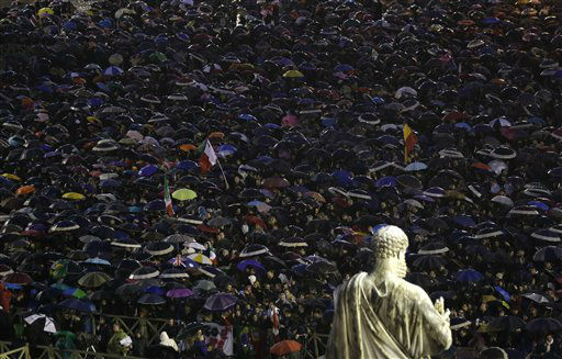 People gather in St. Peter&#39;s Square at the Vatican, Wednesday, March 13, 2013. Cardinals remained divided over who should be pope on Wednesday after three rounds of voting, an indication that disagreements remain about the direction of the Catholic church following the upheaval unleashed by Pope Benedict XVI&#39;s surprise resignation.  <span class=meta>(AP Photo&#47; Luca Bruno)</span>
