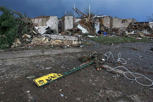 The rubble of a destroyed neighborhood lay where they fell a day earlier Tuesday, May 21, 2013, after a tornado moved through Moore, Okla. The huge tornado roared through the Oklahoma City suburb Monday, flattening entire neighborhoods and destroying an elementary school with a direct blow as children and teachers huddled against winds. &#40;AP Photo&#47;Brennan Linsley&#41; <span class=meta>(AP Photo&#47; Brennan Linsley)</span>