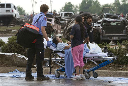 "<div class=""meta ""><span class=""caption-text "">A Moore Medical Center patient sits in the parking lot after a tornado damaged the hospital in Moore, Okla. on Monday, May 20, 2013.  (AP Photo/ Alonzo Adams)</span></div>"