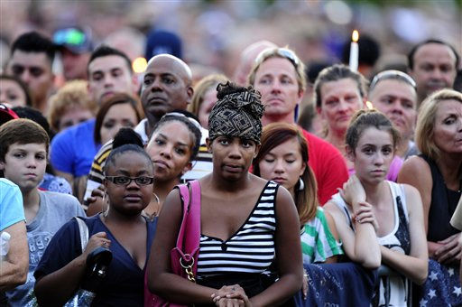 The crowd listens to speakers Sunday, July 22, 2012, in Aurora, Colo., at a prayer vigil for the victims of Friday&#39;s mass shooting at a movie theater. 12 people were killed and 58 were injured in a shooting during an early Friday premiere of ?The Dark Knight Rises.&#34; &#40;AP Photo&#47;The Denver Post, AAron Ontiveroz, Pool&#41; <span class=meta>(AP Photo&#47; AAron Ontiveroz)</span>