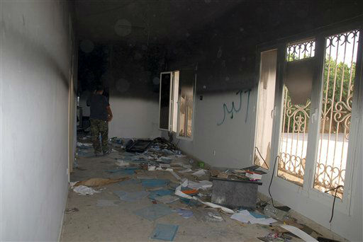 "<div class=""meta image-caption""><div class=""origin-logo origin-image ""><span></span></div><span class=""caption-text"">A man walks through a room in the gutted U.S. consulate in Benghazi, Libya, after an attack that killed four Americans, including Ambassador Chris Stevens, Wednesday, Sept. 12, 2012. The American ambassador to Libya and three other Americans were killed when a mob of protesters and gunmen overwhelmed the U.S. Consulate in Benghazi, setting fire to it in outrage over a film that ridicules Islam's Prophet Muhammad. Ambassador Chris Stevens, 52, died as he and a group of embassy employees went to the consulate to try to evacuate staff as a crowd of hundreds attacked the consulate Tuesday evening, many of them firing machine-guns and rocket-propelled grenades. Partial graffiti reads, ""akbar,"" Arabic for ""great.""(AP Photo/Ibrahim Alaguri) (AP Photo/ Ibrahim Alaguri)</span></div>"