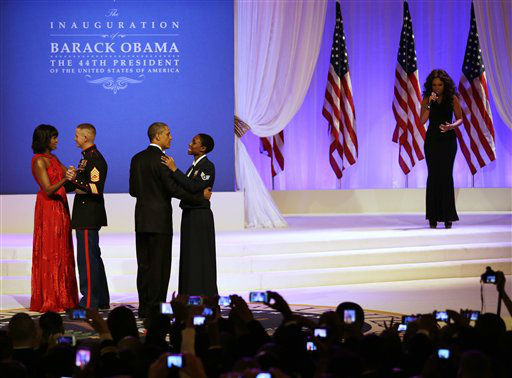 Jennifer Hudson performs while President Barack Obama dances with Air Force Staff Sgt. Bria Nelson as first lady Michelle Obama dances with Marine Corps Gunnery Sgt. Timother Easterling at the Commander-in-Chief&#39;s Inaugural Ball in Washington, at the Washington Convention Center during the 57th Presidential Inauguration Monday, Jan. 21, 2013.   <span class=meta>(AP Photo&#47; Jacquelyn Martin)</span>