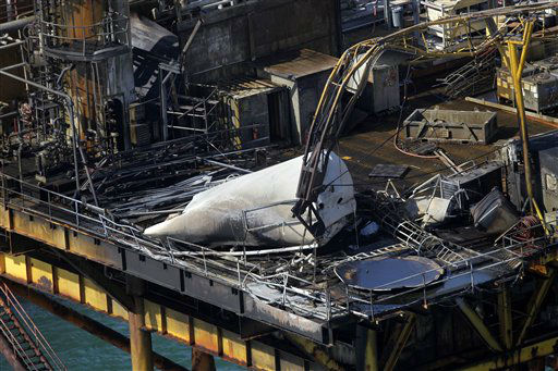 This aerial photograph shows damage from an explosion and fire on an oil rig in the Gulf of Mexico, about 25 miles southeast of Grand Isle, La., Friday, Nov. 16, 2012. Four people were transported to a hospital with critical burns and two were missing.  &#40;AP Photo&#47;Gerald Herbert&#41; <span class=meta>(AP Photo&#47; Gerald Herbert)</span>