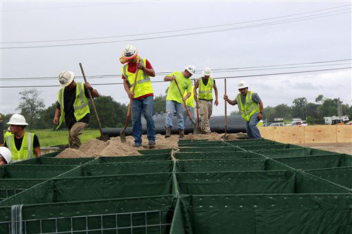 Workers fill Hesco baskets at a flood wall at Route 23, in advance of Tropical Storm Isaac in Plaquemines Parish, La.,  Tuesday, Aug. 28, 2012. Forecasters at the National Hurricane Center warned that Isaac, especially if it strikes at high tide, could cause storm surges of up to 12 feet &#40;3.6 meters&#41; along the coasts of southeast Louisiana and Mississippi and up to 6 feet &#40;1.8 meters&#41; as far away as the Florida Panhandle.   <span class=meta>(AP Photo&#47; Gerald Herbert)</span>