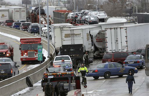 "<div class=""meta ""><span class=""caption-text "">A section of multi-vehicle accident on Interstate 75 is shown in Detroit, Thursday, Jan. 31, 2013. Snow squalls and slippery roads led to a series of accidents that left at least three people dead and 20 injured on a mile-long stretch of southbound I-75. More than two dozen vehicles, including tractor-trailers, were involved in the pileups.   (AP Photo/ Paul Sancya)</span></div>"