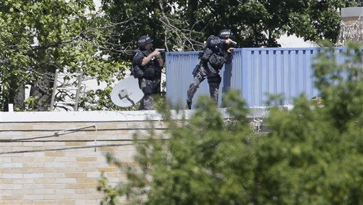Armed police investigate the Sikh Temple in Oak Creek, Wis. where a shooting took place on Sunday, Aug. 5, 2012.   <span class=meta>(AP Photo&#47; Jeffrey Phelps)</span>