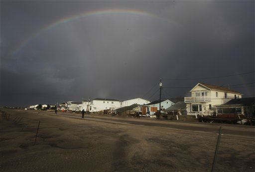 A rainbow forms over Breezy Point in the New York City borough of Queens, in the aftermath of superstorm Sandy, Tuesday, Oct. 30, 2012, in New York. The fire destroyed between 80 and 100 houses Monday night in the flooded neighborhood. &#40;AP Photo&#47;Frank Franklin II&#41; <span class=meta>(AP Photo&#47; Frank Franklin II)</span>