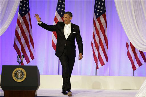 "<div class=""meta ""><span class=""caption-text "">President Barack Obama arrives at the Commander-in-Chief's Inaugural Ball in Washington, at the Washington Convention Center during the 57th Presidential Inauguration on Monday, Jan. 21, 2013.   (AP Photo/ Jacquelyn Martin)</span></div>"
