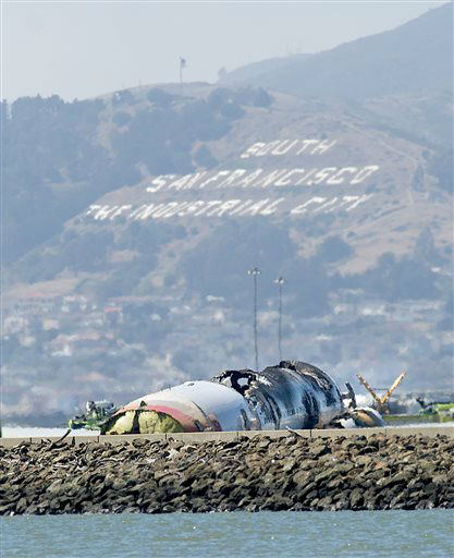 "<div class=""meta ""><span class=""caption-text "">The wreckage of Asiana Flight 214 rests at San Francisco International Airport after it crashed on Saturday, July 6, 2013, in San Francisco.  (AP Photo/ Noah Berger)</span></div>"