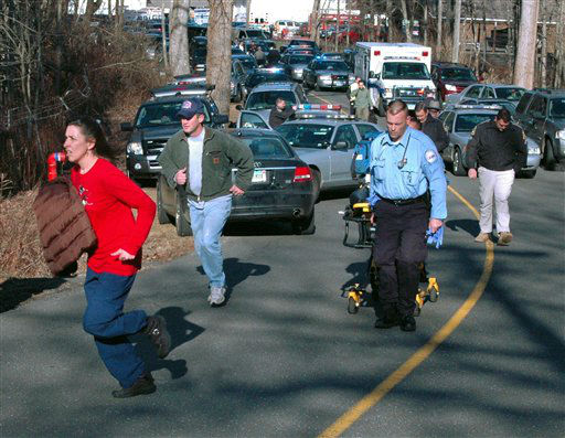 In this photo provided by the Newtown Bee, paramedics and others rush toward Sandy Hook Elementary School in Newtown, Conn., where authorities say a gunman opened fire, killing 26 people, including 20 children, Friday, Dec. 14, 2012. &#40;AP Photo&#47;Newtown Bee, Shannon Hicks&#41;  <span class=meta>(AP Photo&#47; Shannon Hicks)</span>
