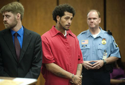 Carlos Ortiz, center,  is shown during a hearing in court in Bristol, Conn., Friday, June 28, 2013. New Britain State&#39;s attorney says investigators arrested the 27-year-old Ortiz in Bristol on Wednesday in connection with the murder case against former New England Patriots tight end Aaron Hernandez. A judge ordered Ortiz turned over to Massachusetts authorities during the hearing.    <span class=meta>(AP Photo&#47; Mike Orazzi)</span>