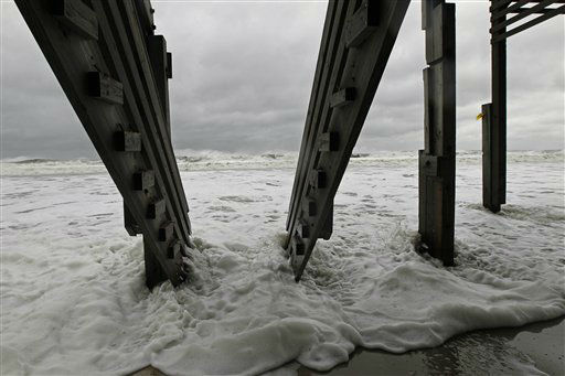 The Atlantic ocean washes under the stairway of an abandoned beach house that survived Hurricane Sandy in Nags Head, N.C., Monday, Oct. 29, 2012. Hurricane Sandy continued on its path Monday, as the storm forced the shutdown of mass transit, schools and financial markets, sending coastal residents fleeing, and threatening a dangerous mix of high winds and soaking rain. &#40;AP Photo&#47;Gerry Broome&#41; <span class=meta>(AP Photo&#47; Gerry Broome)</span>