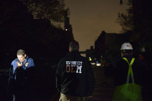 Emergency personnel survey the flood waters in front of a power station on East 14th Street in New York on Monday, Oct. 29, 2012, as Sandy brought wind and rain across the city.   <span class=meta>(AP Photo&#47; Patrick Sison)</span>