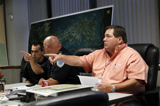 Plaquemines Parish President Billy Nungesser, right, works with other parish officials and law enforcement in their emergency operations center in preparation for tropical storm Isaac, which is expected to make landfall on the Louisiana coast as a hurricane, in Belle Chasse, La., Monday, Aug. 27, 2012.  <span class=meta>(AP Photo&#47; Gerald Herbert)</span>