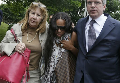 Shayanna Jenkins, middle, fiancee of former New England Patriots football player Aaron Hernandez, is escorted by attorney Janice Bassil, left, and an unidentified attorney after a bail hearing in Fall River Superior Court Thursday, June 27, 2013 in Fall River, Mass. Hernandez, charged with murdering Odin Lloyd, a 27-year-old semi-pro football player, was denied bail.  <span class=meta>(AP Photo&#47; Elise Amendola)</span>