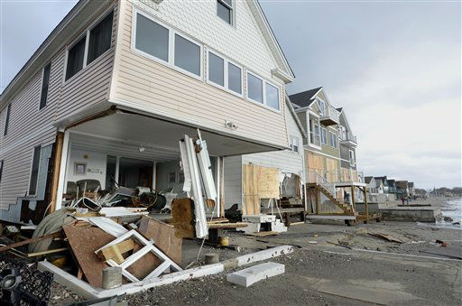 "<div class=""meta ""><span class=""caption-text "">Wreckage lies outsice damaged beach front homes after superstorm Sandy in Milford, Conn., Tuesday, Oct. 30, 2012.   (AP Photo/ Jessica Hill)</span></div>"