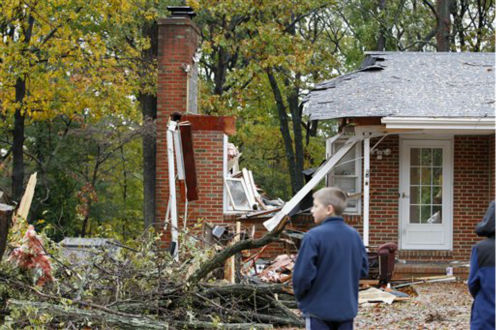 Reece Hiner ,11, take a look at a destroyed home in Pasadena, Md., Tuesday, Oct. 30, 2012, where the homeowner was killed overnight when a tree fell on his home during superstorm Sandy. Neighbor John Brown identified the victim as Donald Cannata Sr. &#40;AP Photo&#47;Jose Luis Magana&#41; <span class=meta>(AP Photo&#47; Jose Luis Magana)</span>